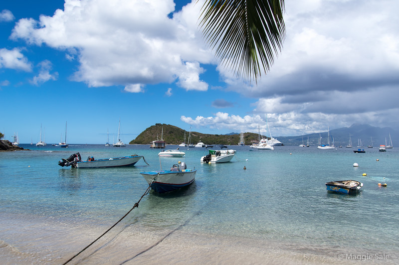The very attractive group of islands known as Les Saintes, part of Guadaloupe. Rain over Guadaloupe in the background.