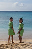 Two girls on the beach in Barbados in their uniforms after school finished.