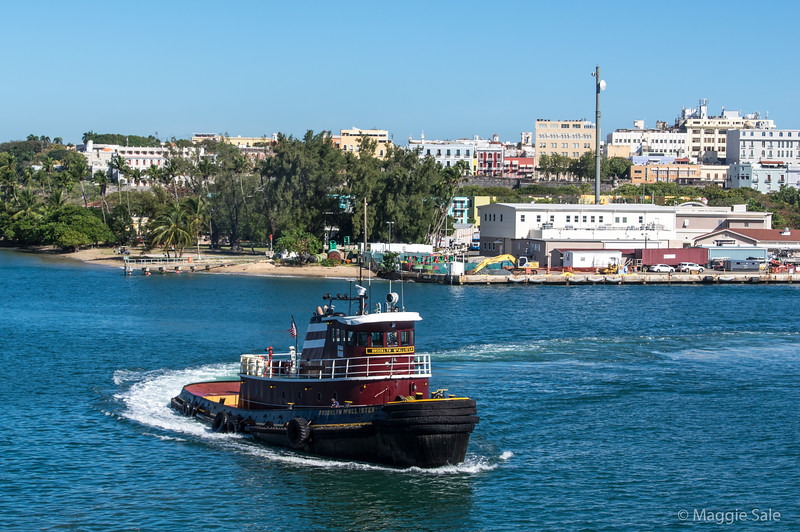 Arriving at San Juan harbour and escorted by a wonderful old tug.
