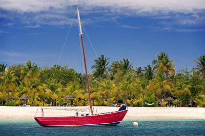 Red Sailboat moored off of Palm Island, Grenadines, West Indies