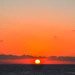 Sun Balancing on the Horizon