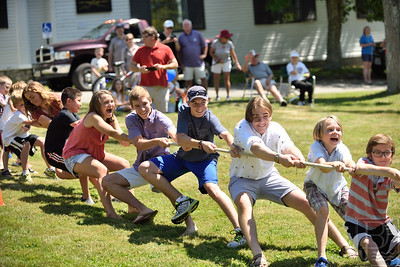 We need a few more on this side...  Dozens of kids young and old participated in a tug-o-war.  Unfortunately, too few on this end caused them to lose to the other side.  Photo by Franklin Brown