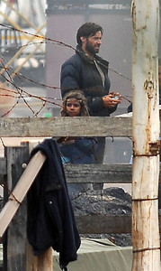 "EXCLUSIVE PHOTOS - BOWEN, AUSTRALIA 24 JUN 2007 - Hugh Jackman and Brandon Walters during a scene where both Hugh and Nicole Kidman's character are in despair over the possible death of Nullah, Brandon Walters' character.  Filming of ""Australia"", the Baz Luhrmann movie currently in production in Bowen, QLD - PHOTO: CAMERON LAIRD (PH 0418 238811)"