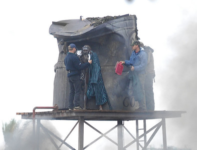 "BOWEN, QLD 22 JUN 2007 - On one of the coldest days in Bowen's history David Gulpilil spent the morning in a loin cloth on top of a water tower during filming of ""Australia"", the Baz Luhrmann film currently in production.  David was closely guarded by minders sporting hot water bottles, insulation blankets and fleece dressing gowns - PHOTO: CAMERON LAIRD (PH 0418 238811)"