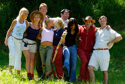 "GOLD COAST, AUSTRALIA / 10-FEB-2004 Kerry and Jordan Kiss - Kerry McFadden celebrates her win in ""I'm a Celebrity, Get me out of Here"" along with the rest of the celebrities (front row from left - Alex Best, Jennie Bond, Jordan, Kerry McFadden, Diane Modahl, Peter Andre, Charles Brocket / back row from left - Mike Read, Neil Ruddock) PHOTO: CAMERON LAIRD (Ph: +61 (0)418238811)"