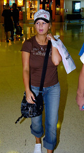 "BRISBANE, AUSTRALIA / 11-FEB-2004 A jungle-weary Kerry McFadden leaves Australia after her win in ""I'm a Celebrity, Get me out of Here"" PHOTO: CAMERON LAIRD (Ph: +61 (0)418238811)"
