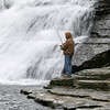 A fisherman near Ithaca Falls in Ithaca New York - October 21, 2009