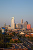 Charlotte skyline in late afternoon, sun shining on the buildings