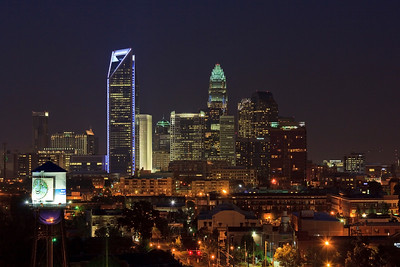 Charlotte Skyline - Duke Energy Center Tower lit up in blue.  (Southend Water Tower in the left corner.)