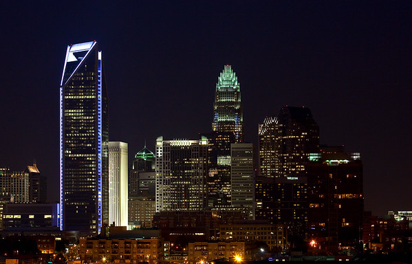 Charlotte Skyline - Duke Energy Center Tower lit up in blue.<br /> <br /> Fits 20x30 Box Framed (Ready to Hang)