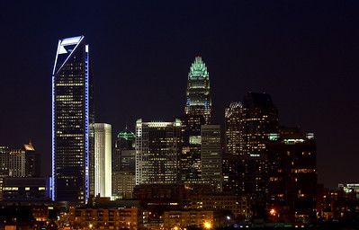 Charlotte Skyline - Duke Energy Center Tower lit up in blue.  Fits 20x30 Box Framed (Ready to Hang)