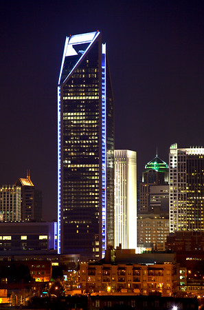 Duke Energy Center Tower lit up in blue.