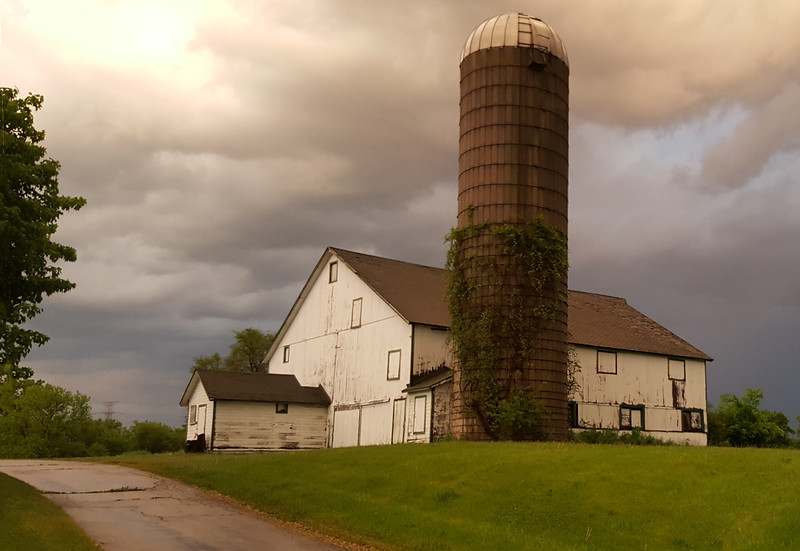 A barn lit by the sunset at the end of a stormy day. Near Woodstock, IL.