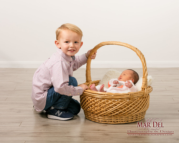 big brother with baby portrait