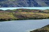 Across an endorheic lagoon to the glacial milk/flour water of Lago Nordenskjold - and distal lower slope of Cuernos del Paine, displaying several dikes (sheet intrusions).