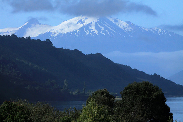 Across the northeastern slopes, along the fjord or estuary Reloncavi - to the glacial ice slopes of Volcan Yate, up in the cumulus clouds.
