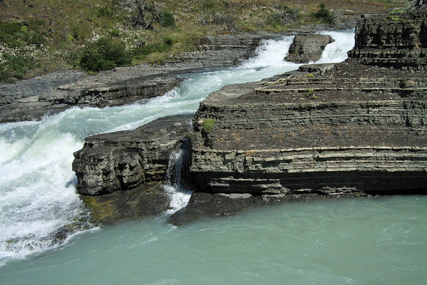 Paine River Waterfall (a chute falls) -  along the sedimentary rock, with a few cushion plants growing upon.