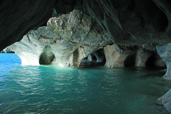 Several thousand years of water erosion and sculpting, forming the metamorphic marble sea caves and arches of the Capillas de Marmol Nature Santuary - Lago Carrera - Aisen region.