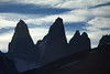 Late evening upon the Torres del Paine - Torre Sur, with the glacier below - beyond to Cerro Fortaleza - Torre Central - the twin peak of Torre Norte - and the jagged Cerro Nido Condor (r) - with the foreground slopes of Cerro Paine (r) and Mt. Almirante Nieto (l), and the sunlit stratus clouds above.