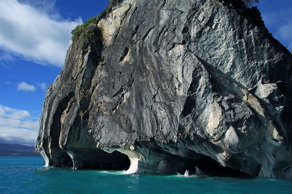 Metamorphic marble arches and sea caves along Marble Cathedral (Catedral de Marmol).
