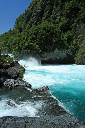 Glacial milk or rock flour water, of the Petrohue Waterfalls - among the igneous rock and Valdivian vegetation.