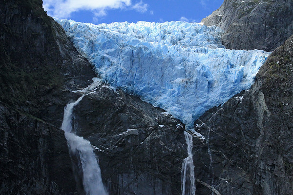 Ventisquero Colgante - with is plunge falls and cascade waterfall, among the intrusive igneous rock.