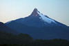 Day's first rays upon the igneous basalt and glacial ice peak, of Volcan Cordovado.