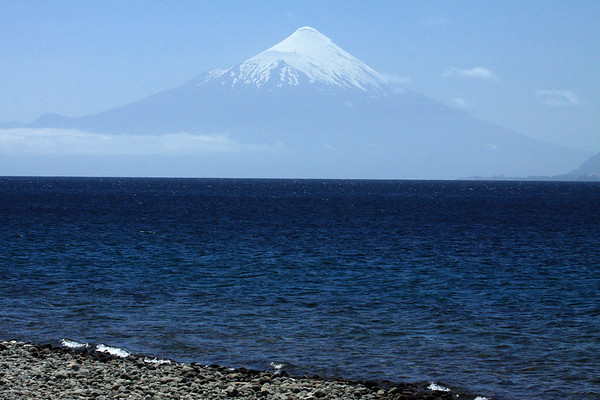 Vicente Perez Rosales National Park (1926) - the 1st or oldest national park of Chile - viewing northeastward, across Lago Llanquihue - to the summetrical glacial ice cone, of Volcan Osorno, rising to about 8,730 ft. (2,661 m) - along the Patagonia Andes - Llanquihue province, Los Lagos region, southern Chile.