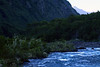 Down the rapids and glacial milk water, of the Rio Petrohue - along the steep forested western slope, of the Sierra Santo Domingo - to the distal sunlit slope, of Volcan Calbuco.