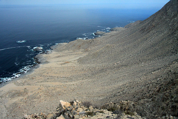 From the cliff along the Coastal Range, at about 1,040 ft. (317 m) - viewing northwestward across down the slope of the Coastal Range - central area, of the Pan Azucar National Park - Atacama region, northern Chile.