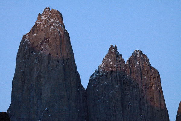 Morning light upon the glacial sculpted igneous granite spire of Cerro Sur - and twin peaks of Cerro Norte.