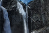 2) Calving of the Ventisquero Colgante - airborne glacial ice fragments, free-falling with the glacial rock flour water, of the adjacent plunge falls, among the igneous rock.