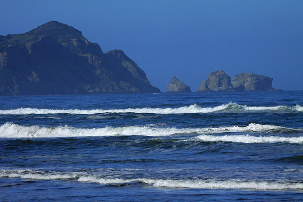 Waves near the shore of Bahia Cucao - to Punta Pirulil, rising about 400 ft. (120 m) - and the water-sculpted sea stacks, along the western coastline of Isla Chiloé.