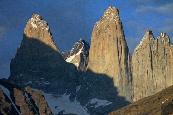 Towers of Paine - Torre Sur, beyond its northern buttress to the distal Cerro Fortaleza -  Torre Central and the adjacent twin towers of Torre Norte - with the foreground slopes of Cerro Paine (r) and Mt. Almirante Nieto (l).