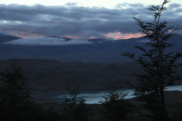 From the silhouette of the southern beech trees - down to the northeastern end of Lago Nordenskjold, with the mouth of Rio Asencio (l) - and the clouds along the distal ridge of Cerro Toro.