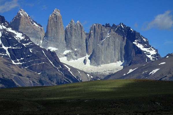 Across the partially sunlit Patagonia Steppe ecoregion terrain - past the northern slope of Mount Almirante Nieto (l) - to the Towers of Paine, and Cerro Nido Condor - and distal glimpses of Cerro Fortalez (between Torre Sur and Central), and Cerro Escudo (between Torre Norte and Cerro Nico Condor).