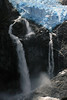 1) Calving of the Ventisquero Colgante - between the crest of its plunge waterfalls, among the igneous rock.