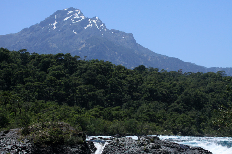 Beyond the rapids along the Rio Petrohue - beyond the forested Valdavian vegetation - to Cerro Picada, and its glacial ice streams.