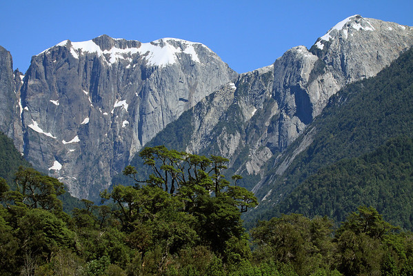 Beyond the southern beech trees, of the Valdivian Temperate Rainforest, along the steep slopes - to the glacial sculpted intrusive igneous granite, of Cerro Sombrero - the Patagonia Andes - Corcovado National Park.