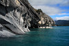 Along the western shoreline of Lago Carrera - viewing northeastward, along the water sculpted marble columns, arches, and sea caves - across the Islas Malvinas, to the glacial ice among the cumulus clouds - Aisen region, the least populated of Chile's 15 regions.