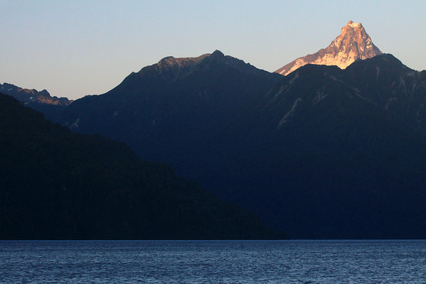 Day's last rays upon Volcan Puntiagudo, displaying is glacial ice and igneous rock peak.