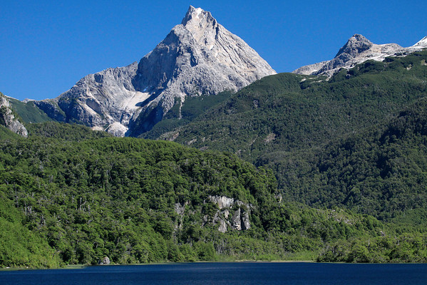 Lago las Torres (Towers Lake) National Reserve - across the  glacial formed lake water, to southern beech trees and steep igneous rock to Cerro Picacho.