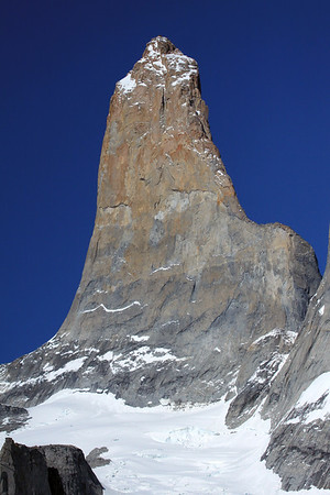 Torre Sur, also know as Torre D'Agostini - the tallest of the 3 Torres del Paine, rising to about 9,350 ft. (2,850 m), first ascent in 1963 - with the glacier below, and lower slope of Torre Central (r).