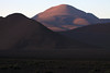 Day's first rays upon Cerro Cuevas - from beyond the lower foothills, of Cerro Palpana - Alto Loa National Reserve.