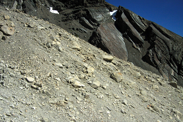 Across the glacial granite till, along the lateral moraine - to the metamorphic rock, along the lower slope of Cerro Nido Condor.