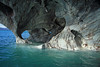Water sculpted metamorphic calcite marble arches, of Capilla de Marmol, a glacial formed sea stack upon Lago Carrera.