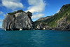 Catedral de Marmol (Marble Cathedral) - adjacent another smaller vegetated marble island or sea stack and several fallen scree boulders - along the western shoreline of Lago Carrera - Aisen region, characterized by glaciation - southern Chile.