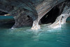 Water eroded marble tunnel and arches, along the base of the Capilla de Marmol - upon the glacial water of Lago Carrera.