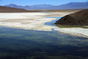 Laguna Santa Rosa - Salar de Maricunga - a closed high-mountain basin and endorheic lagoon - here viewing northeastward, with the lower northern slope of Cerro Pastillitos (r), the lower eastern sloper of Cerro Maricunga (l), with Cerro la Sal beyond - and the snow covered ridges of the Cordillera Claudio Gay, along the horizon (r).