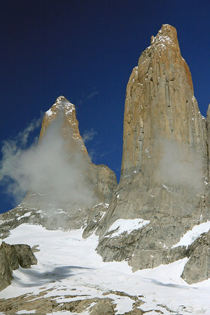 Beyond the snow-covered glacier and clouds - to Torre Sur (l) and Torre Central (r).